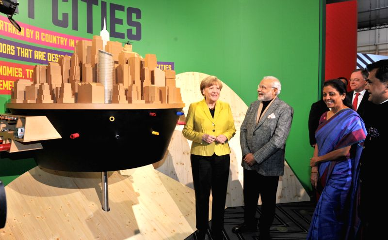 Prime Minister Narendra Modi and the German Chancellor Angela Merkel at the Joint Inauguration of the India Pavilion and the Joint Walk-About Make in India, in Hannover, Germany on April ... - Narendra Modi