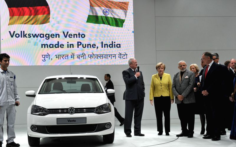 Prime Minister Narendra Modi and the German Chancellor Angela Merkel at the Joint Walk About, at the Hannover Messe, in Germany on April 13, 2015. - Narendra Modi