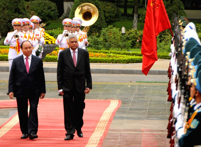 HANOI, April 17, 2017 - Vietnamese Prime Minister Nguyen Xuan Phuc (L front) and his Sri Lankan counterpart Ranil Wickremesinghe review a guard of honor during a welcoming ceremony held in Hanoi, ... - Nguyen Xuan Phuc