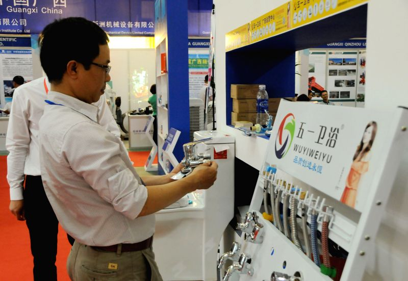 HANOI, April 19, 2017 - A man visits a Chinese booth at the 27th Vietnam International Trade Fair in Hanoi, Vietnam, April 19, 2017. The 27th Vietnam International Trade Fair or Vietnam Expo 2017 ...