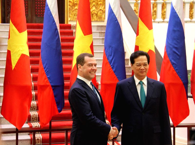 Vietnamese Prime Minister Nguyen Tan Dung (R) welcomes his visiting Russian counterpart Dmitry Medvedev in Hanoi, Vietnam, April 6, 2015. At the invitation of Nguyen ... - Nguyen Tan Dung