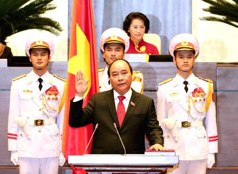 HANOI, April 7, 2016 - Nguyen Xuan Phuc (Front) is sworn in after being elected as the country's prime minister in Hanoi, capital of Vietnam, on April 7, 2016. Nguyen Xuan Phuc was elected by the ...