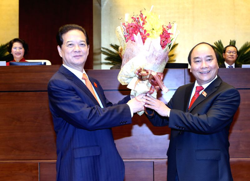 HANOI, April 7, 2016 - Vietnamese Prime Minister Nguyen Xuan Phuc (R) presents a bouquet of flowers to former Vietnamese Prime Minister Nguyen Tan Dung in Hanoi, Vietnam, April 7, 2016. Vietnamese ... - Nguyen Xuan Phuc