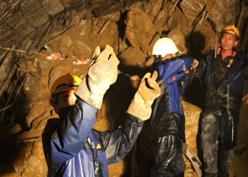 Rescue team works at the site of a tunnel collapse in Vietnam's central highlands Lam Dong province, Dec. 16, 2014. Twelve workers trapped Tuesday in a tunnel ...