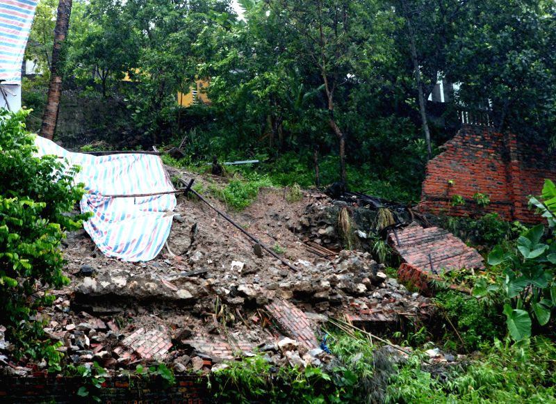 Photo taken on July 19, 2014 shows a collapsed house caused by typhoon Rammasun in Ha Long city, Quang Ninh province, Vietnam. Two houses were collapsed while roofs ..
