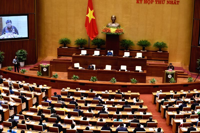 HANOI, July 20, 2016 - Photo taken on July 20, 2016 shows deputies attending the first session of the 14th National Assembly of Vietnam in Hanoi, capital of Vietnam. The first session of the 14th ...
