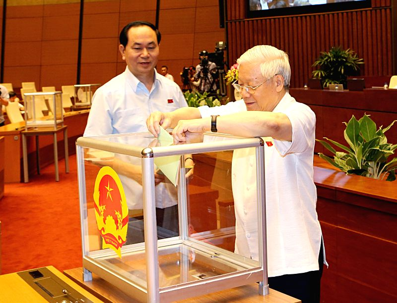 HANOI, July 21, 2016 - General Secretary of the Communist Party of Vietnam Central Committee Nguyen Phu Trong (R) casts his ballot to elect Chairperson of the 14th National Assembly (NA) in Hanoi, ...