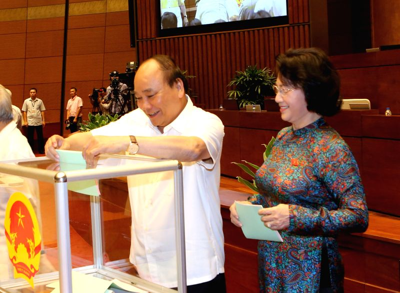 HANOI, July 21, 2016 - Vietnamese Prime Minister Nguyen Xuan Phuc (L) casts his ballot to elect Chairperson of the 14th National Assembly (NA) in Hanoi, Vietnam, July 21, 2016. Vietnamese National ... - Nguyen Xuan Phuc