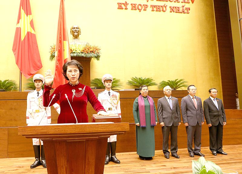 HANOI, July 22, 2016 - Nguyen Thi Kim Ngan (front) makes her sworn-in statement in Hanoi, Vietnam, July 22, 2016. Nguyen Thi Kim Ngan, chairwoman of the 13th National Assembly (NA) of Vietnam, was ...