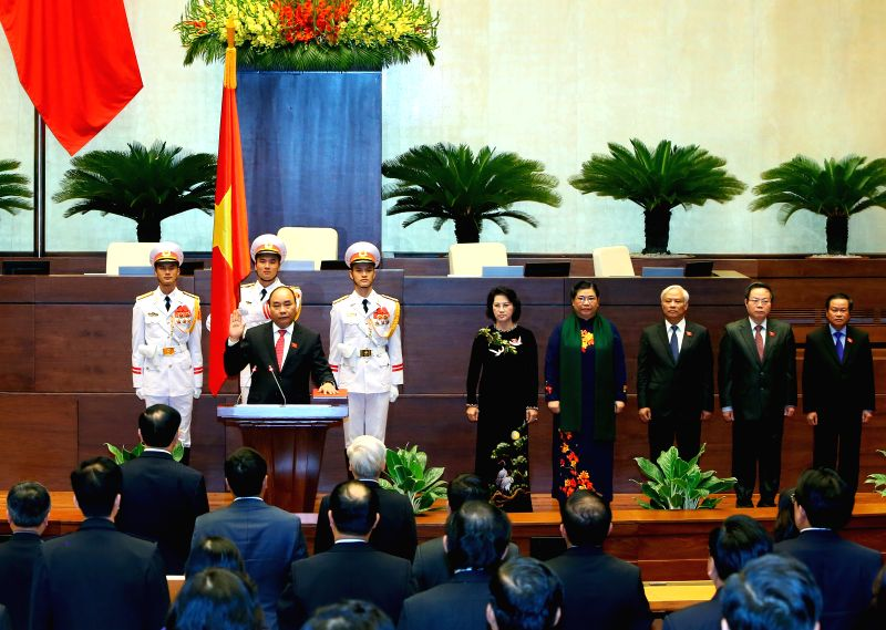 HANOI, July 26, 2016 - Vietnamese Prime Minister Nguyen Xuan Phuc (L, front) makes his sworn-in statement in Hanoi, capital of Vietnam, July 26, 2016. Nguyen Xuan Phuc was re-elected Prime Minister ... - Nguyen Xuan Phuc
