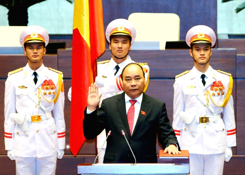 HANOI, July 26, 2016 - Vietnamese Prime Minister Nguyen Xuan Phuc makes his sworn-in statement in Hanoi, capital of Vietnam, July 26, 2016. Nguyen Xuan Phuc was re-elected Prime Minister of Vietnam ... - Nguyen Xuan Phuc