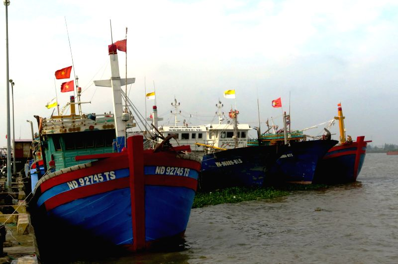 HANOI, July 27, 2016 - Photo taken on July 27, 2016 shows fishing boats taking shelter in Nam Dinh province, northern Vietnam. Vietnam is preparing to brace for storm Mirinae which is forecast to ...