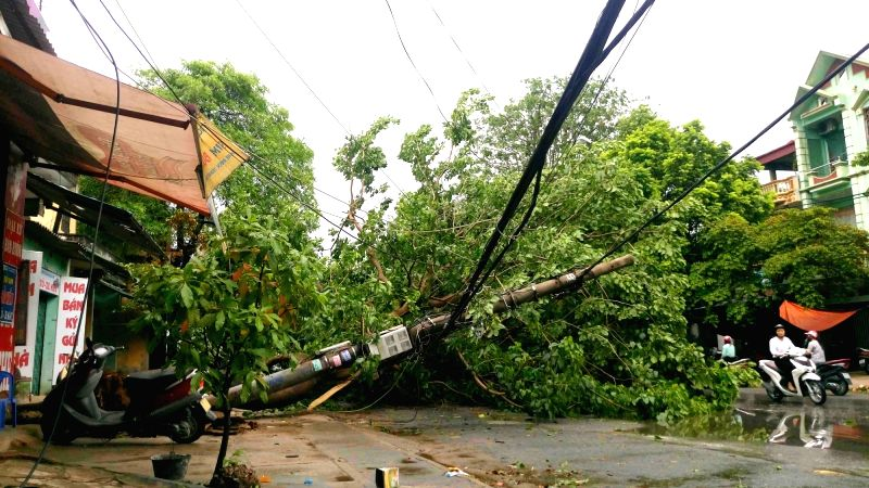 HANOI, July 28, 2016 - Photo taken on July 28, 2016 shows a damaged electric pole in Hanoi, capital of Vietnam. Storm Mirinae made landfall in northern Vietnam on Wednesday night, bringing strong ...