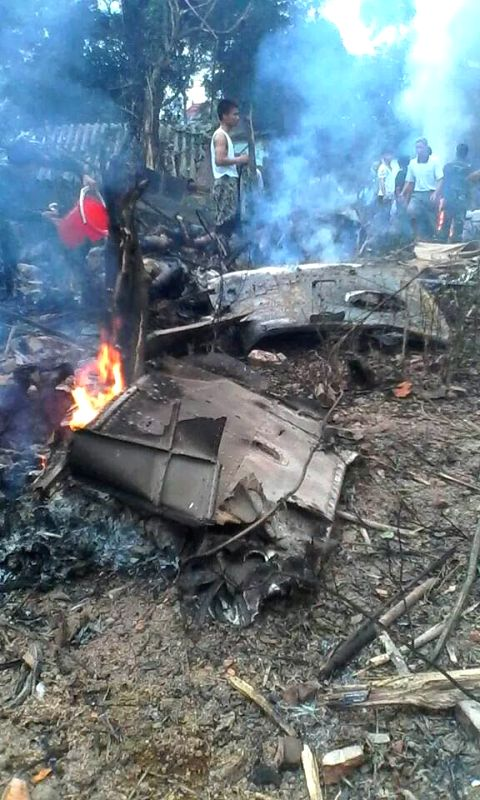 Photo taken on July 7, 2014 shows a military helicopter crashed in the west of Vietnamese capital Hanoi on Monday morning, killing 16 people and injuring five. ...