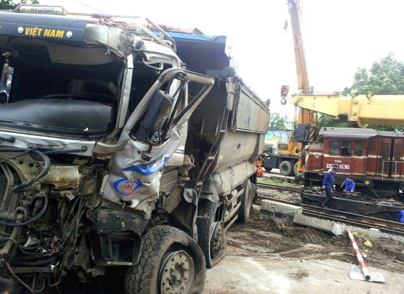 A seriously damaged truck is seen at the site of a train accident in Vietnam's northern Thai Nguyen province, June 26, 2014. The accident happened on Wednesday ...