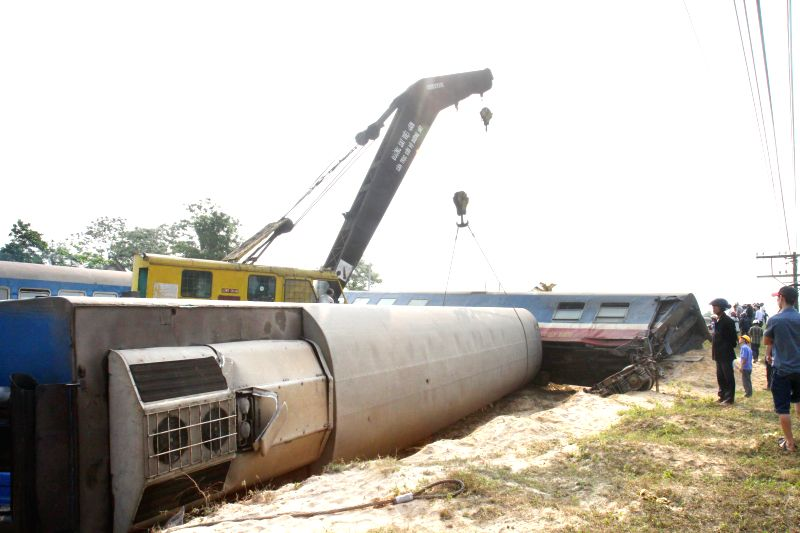 Photo taken on March 11, 2015 shows the site of an accident between a train and a truck in Quang Tri province, Vietnam. A serious traffic accident happened between a ...