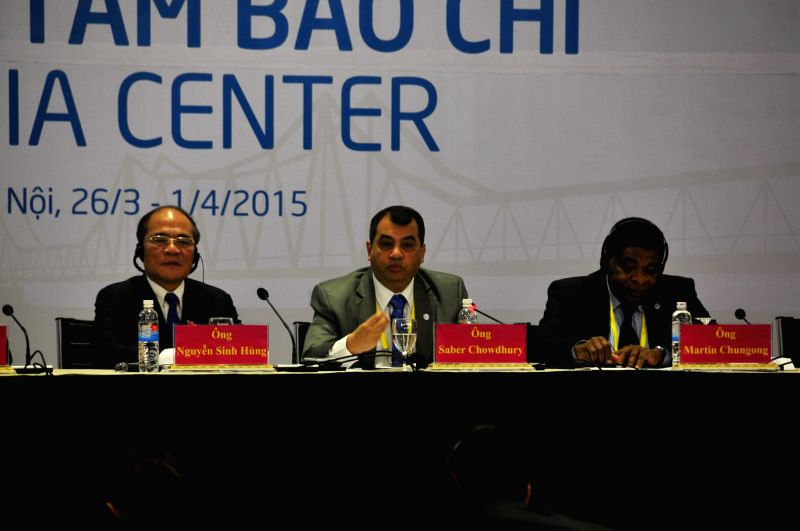President of the Inter-Parliamentary Union (IPU) Saber Chowdhury (C) answers questions during a press conference of the 132nd Assembly of IPU in Hanoi, Vietnam, on ...