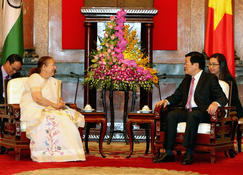 Vietnamese President Truong Tan Sang (R, front) meets with Sumitra Mahajan (L, front), speaker of the Lok Sabha, the lower house of India's parliament, in Hanoi, ... - Sumitra Mahajan