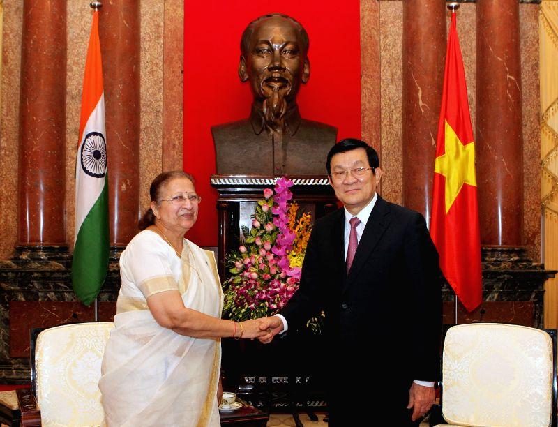 Vietnamese President Truong Tan Sang (R) shakes hands with Sumitra Mahajan, speaker of the Lok Sabha, the lower house of India's parliament, in Hanoi, capital of ... - Sumitra Mahajan