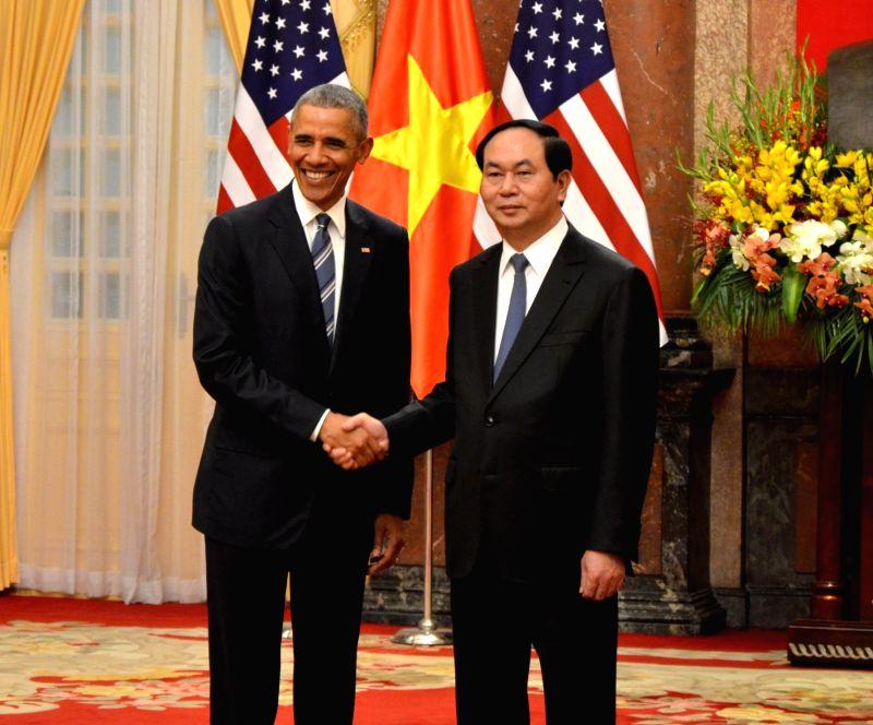 HANOI, May 23, 2016 - Vietnamese President Tran Dai Quang (R) shakes hands with U.S. President Barack Obama in Hanoi, capital of Vietnam, May 23, 2016. Barack Obama arrived at Noi Bai International ...