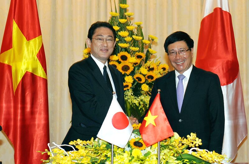 HANOI, May 6, 2016 - Vietnamese Deputy Prime Minister and Minister of Foreign Affairs Pham Binh Minh (R) co-chairs a press conference after the eighth meeting of the Vietnam-Japan Cooperation ... - Fumio Kishida