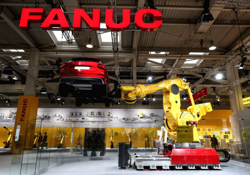HANOVER, April 25, 2017 - A robot lifts a car at Fanuc's stand of the Hanover Messe 2017 in Hanover, Germany, on April 24, 2017. The Hanover Messe started on Monday, and will last until April 28. ...