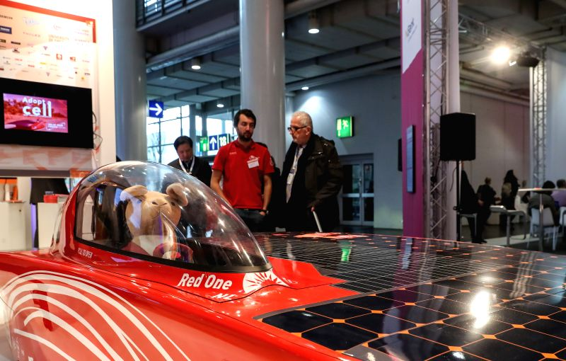 HANOVER, April 25, 2017 - Fair-goers view the model of a solar powered vehicle during the Hanover Messe 2017 in Hanover, Germany, on April 24, 2017. The Hanover Messe started on Monday, and will last ...