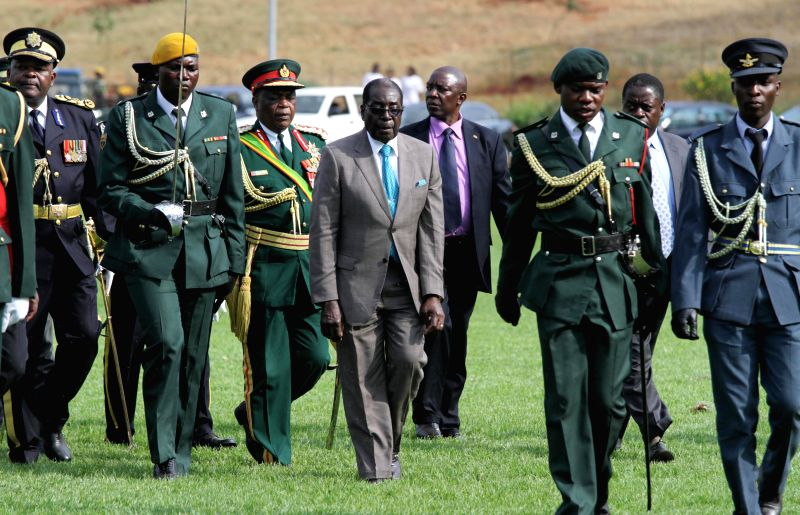 Zimbabwean President Robert Mugabe (C) attends the opening ceremony of the 104th Harare Agricultural Show, in Harare, Zimbabwe, Aug. 22, 2014.