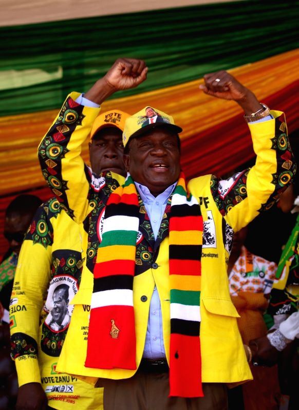 HARARE, Aug. 3, 2018 - Emmerson Mnangagwa (front) attends a rally in Harare, Zimbabwe, on July 28, 2018. Zimbabwe Electoral Commission (ZEC) declared early Aug. 3 that current President Emmerson ...