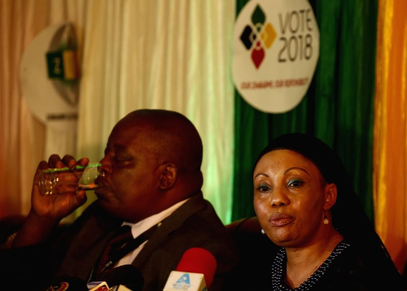 HARARE, Aug. 3, 2018 - Zimbabwe Electoral Commission (ZEC) chairperson Priscilla Chigumba (R) addresses a press conference in Harare Aug. 2, 2018. The ZEC announced early Friday that incumbent ...