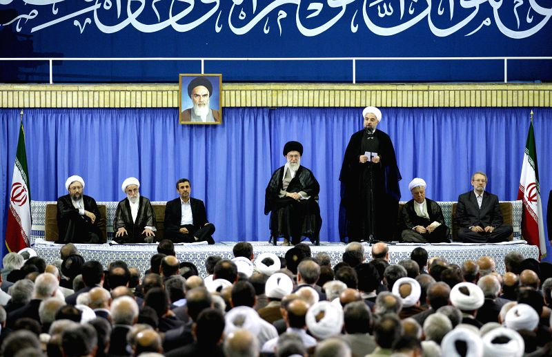 HARARE, Aug. 4, 2013 (Xinhua/IANS) -- -- Photo provided by Iranian Supreme Leader's Office on Aug. 3, 2013, shows Iranian new president Hassan Rouhani (3rd R) speaks during an endorsement ceremony in Tehran, Iran. Iran's Supreme Leader Ayatollah Ali