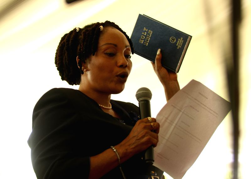 HARARE, Feb. 1, 2018 - Newly appointed Zimbabwe Electoral Commission chairperson Priscilla Chigumba swears an oath during the swearing-in ceremony in Harare, Zimbabwe, Feb. 1, 2018. Newly appointed ...