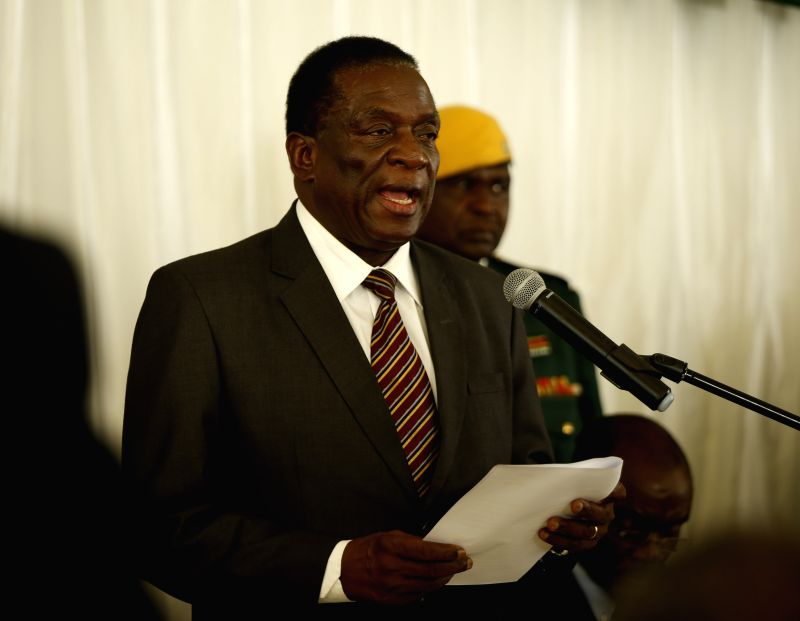 HARARE, Feb. 1, 2018 - Zimbabwean President Emmerson Mnangagwa (front) speaks during the new Zimbabwe Electoral Commission chairperson Priscilla Chigumba's swearing-in ceremony in Harare, Zimbabwe, ...