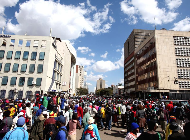 HARARE, July 21, 2016 - President Robert Mugabe's supporters march in the city center of Harare, capital of Zimbabwe, July 20, 2016. Thousands of President Robert Mugabe's supporters marched across ...