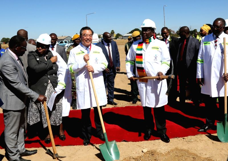 HARARE, July 23, 2018 - Zimbabwean President Emmerson Mnangagwa (2nd R, Front) and Chinese Ambassador to Zimbabwe Huang Ping (3rd L, Front) lay the foundation of the upgrading and expansion project ...