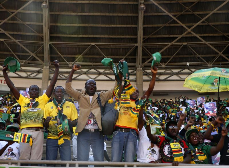 HARARE, July 28, 2018 - Supporters of the ruling ZANU-PF party attend a rally in Harare, Zimbabwe, on July 28, 2018. Zimbabwean President Emmerson Mnangagwa ended his election campaign Saturday and ...
