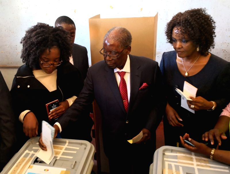 HARARE, July 30, 2018 - Former Zimbabwean president Robert Mugabe (C) votes in Highfield, Harare, Zimbabwe, July 30, 2018. Zimbabweans began voting on Monday in the African country's first ...