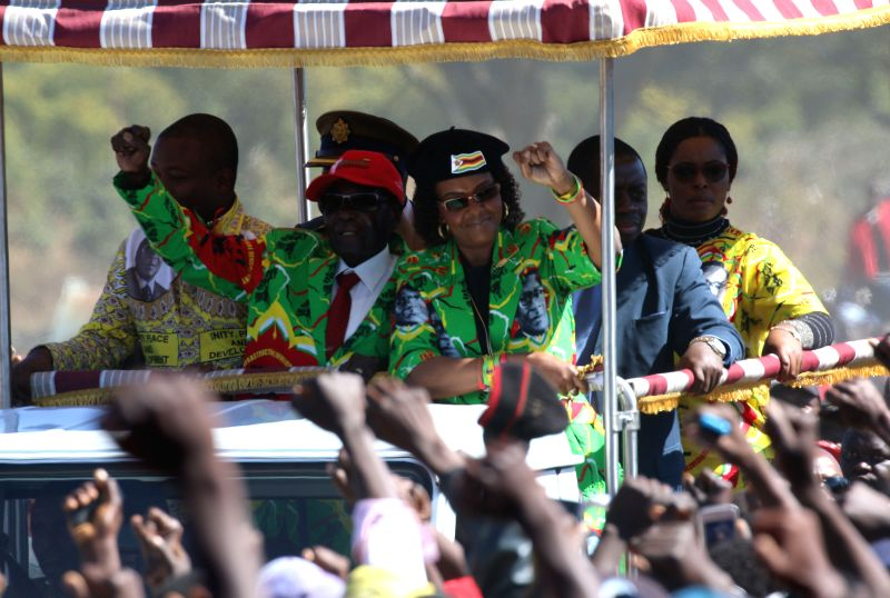 HARARE, June 3, 2017 - Zimbabwean President Robert Mugabe (L, front) and his wife Grace (R, front) gesture to supporters in the Mashonaland East provincial capital Marondera, about 80 km south of ...