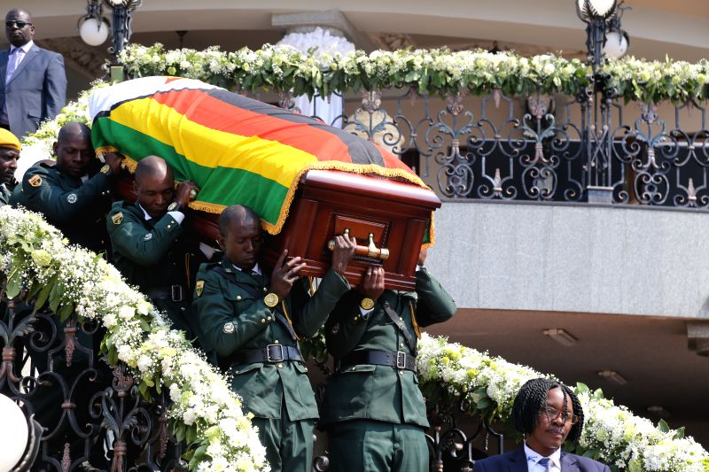 HARARE, Sept. 13, 2019 (Xinhua) -- The casket of the late former Zimbabwean President Robert Mugabe is taken out of his residence in Harare, Zimbabwe, on Sept. 13, 2019. Thousands of Zimbabweans thronged Rufaro Stadium in Harare on Friday for the con
