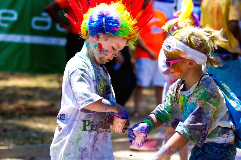 Two children attend the Color Run in Harare, Zimbabwe, Dec. 6, 2014. The five-kilometer un-timed race is held to promote healthy living and benefit charity.