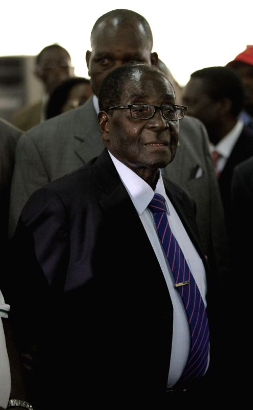 Harare (Zimbabwe): Zimbabwean President Robert Mugabe arrives at the venue for the ruling ZANU PF party's elective congress in Harare, Zimbabwe, Dec. 1, 2014. The congress is to start on Tuesday and .