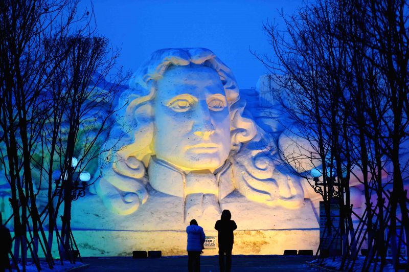 Tourists visit the 27th Sun Island Snow Sculpture Expo in Harbin, capital of northeast China's Heilongjiang Province, Feb. 5, 2015.  (Xinhua/Wang Jianwei)