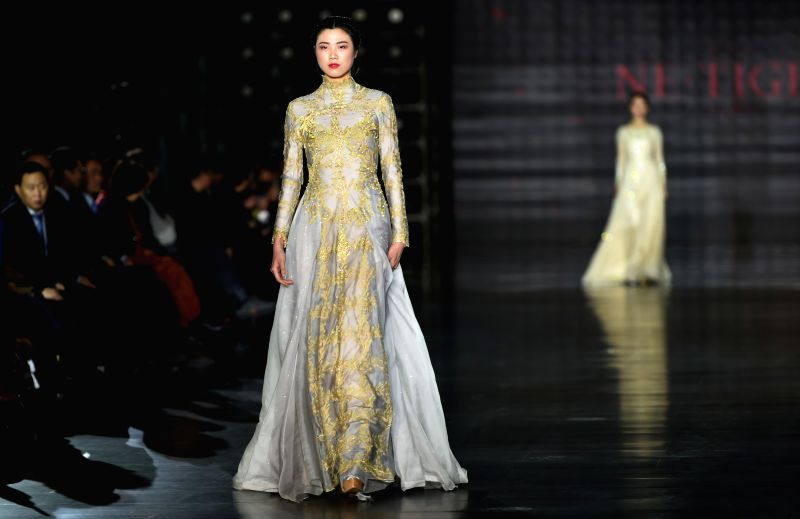 HARBIN, Jan. 12, 2018 - Models show creations at the 2018 Harbin Fashion Week in Harbin, capital of northeast China's Heilongjiang Province, Jan. 12, 2018. The fashion week, which will last for 5 ...