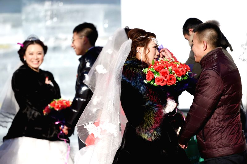 Couples take part in a group wedding in Harbin, capital of northeast China's Heilongjiang Province, Jan. 6, 2015. A total of 11 couples from China, Russia, France, ...