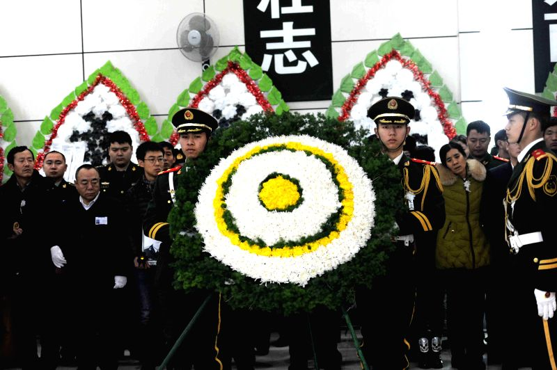 Soldiers carry a wreath at the funeral for five firefighters in Harbin, capital of northeast China's Heilongjiang Province, Jan. 8, 2015. A serious fire broke out at .