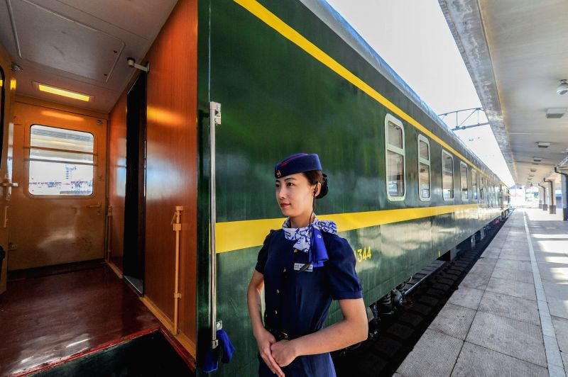 HARBIN, May 31, 2016 - A conductor waits outside a carriage of tourist train from Harbin to Heihe, northeast China's Helongjiang Province, May 31, 2016.  To meet the needs of tourists, the railway ...