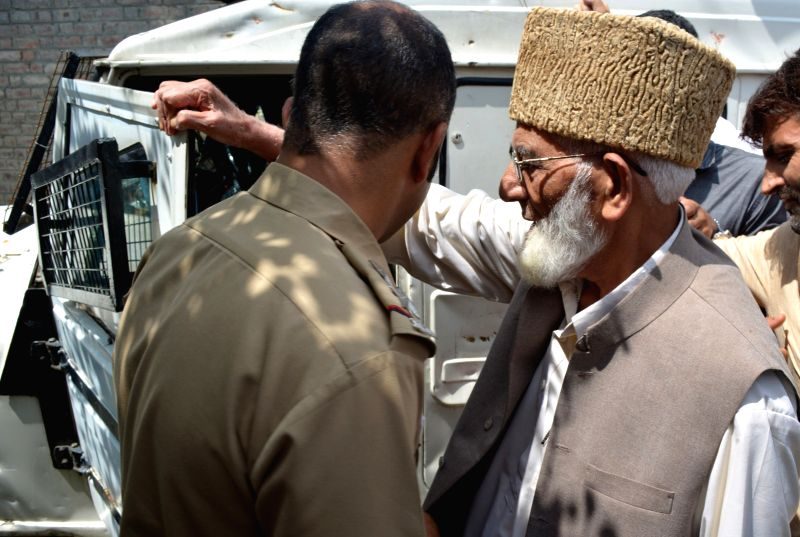 Hardline Hurriyat Conference chairman Syed Ali Shah Geelani being taken away by police after he tried to to proceed towards Eidgah in Srinagar on Aug 11, 2016.