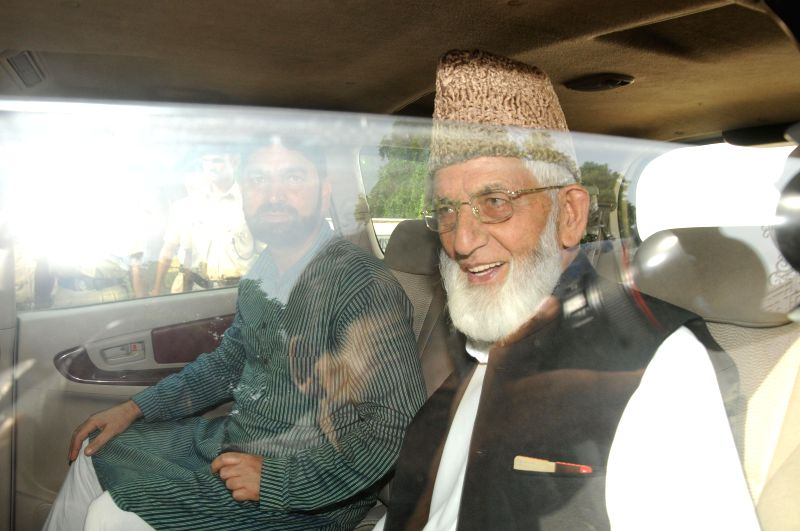 Hardline Hurriyat leader Syed Ali Shah Geelani leaves Pakistan High Commission after meeting Pakistan High Commissioner Abdul Basit in New Delhi on Aug 19, 2014.