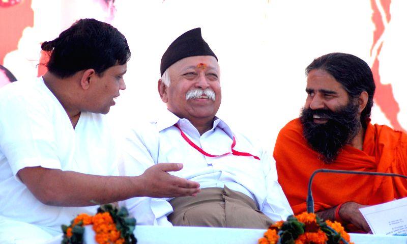 RSS chief Mohan Bhagwat with Yoga guru Ramdev and Acharya Balkrishna during an RSS programme in Haridwar on Nov 30, 2014.