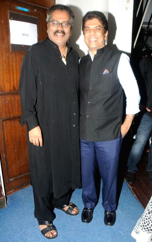 Hariharan and Saurabh Daftary during the Jagjit Singh's brother Kartar Singh's book launch in Mumbai on July 18, 2014. - Jagjit Singh
